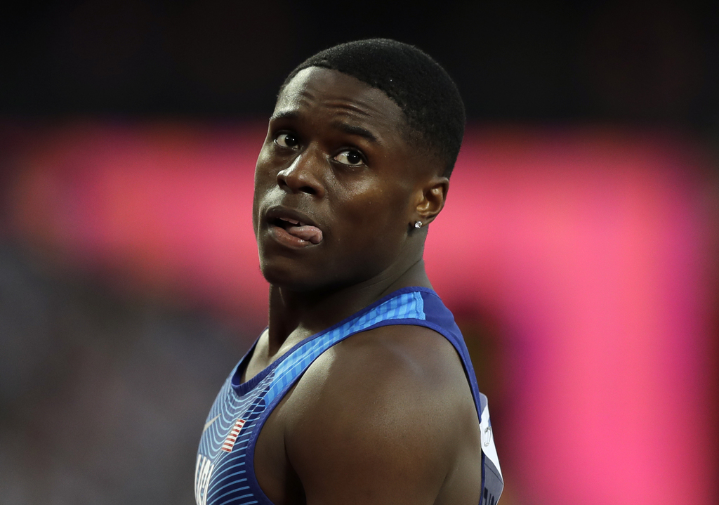 United States' Christian Coleman reacts after completing a Men's 100 meters heat during the World Athletics Championships in London Friday, Aug. 4, 20...