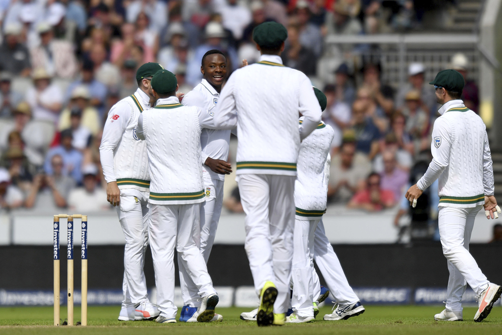 South Africa's Kagiso Rabada, third left, celebrates as England's Moeen Ali is caught behind by South Africa's Quinton de Kock during day two of the F...