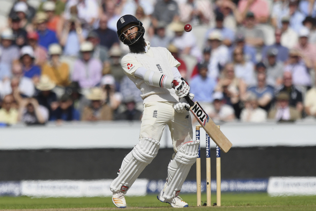 England's Moeen Ali avoids a bouncer from South Africa's Kagiso Rabada, during day two of the Fourth Test at Emirates Old Trafford in Manchester, Engl...