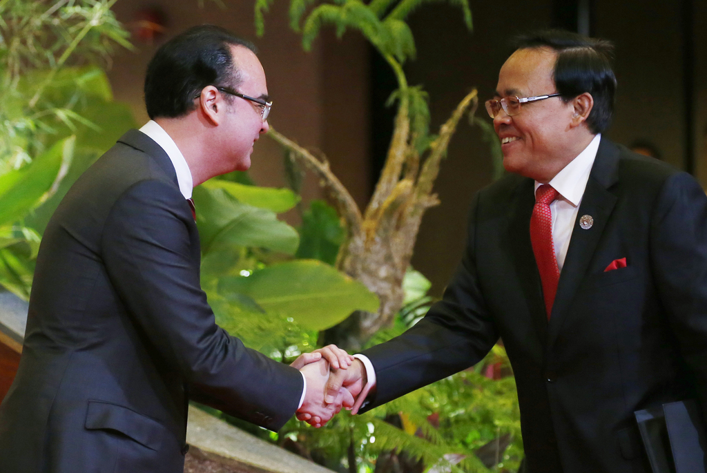 Philippine Foreign Affairs Secretary Alan Peter Cayetano, left, greets Myanmar's Foreign Minister Kyaw Tin during a reception for the 50th Association...