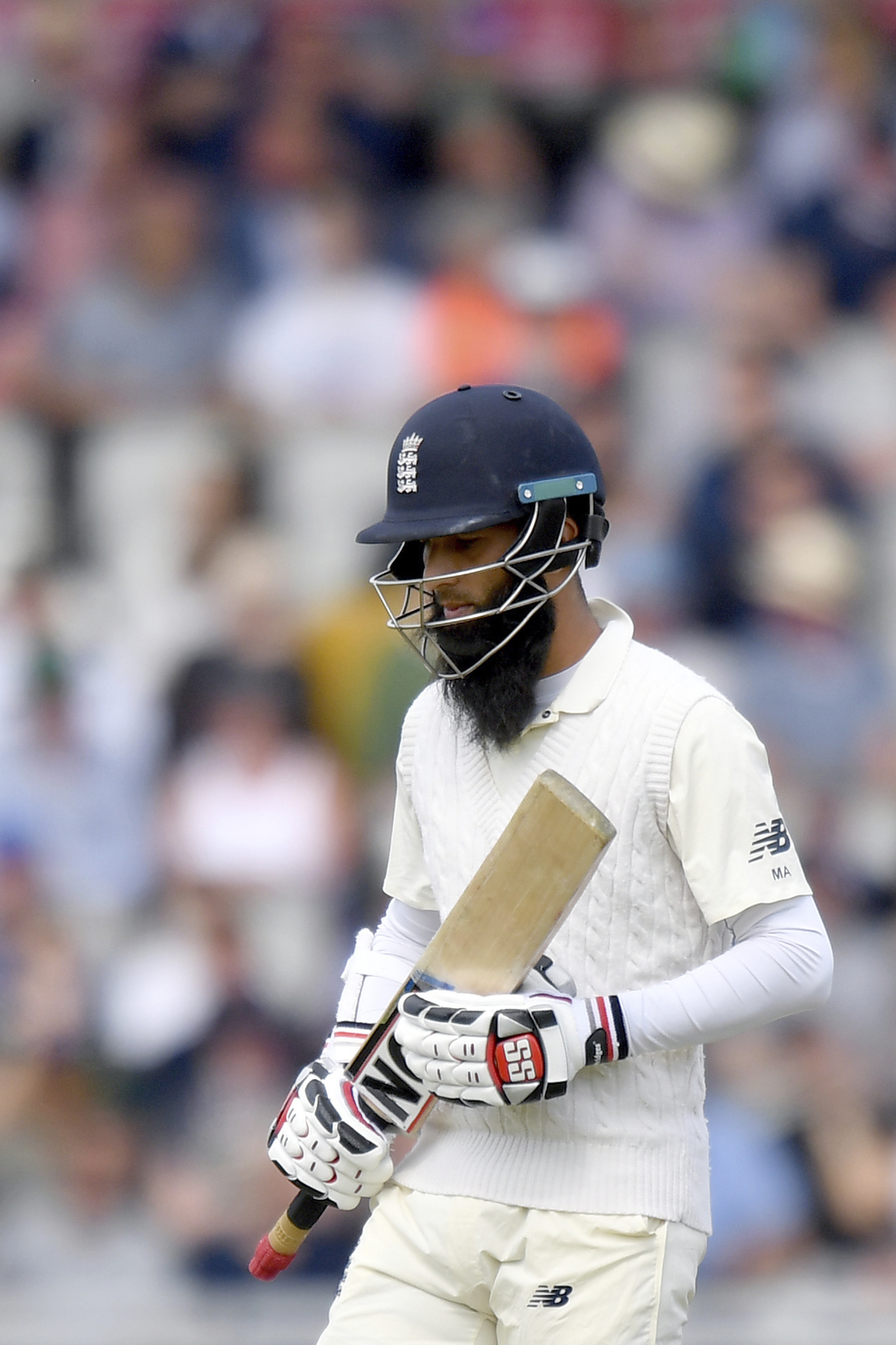 England's Moeen Ali leaves the field after being caught behind by South Africa's Quinton de Kock during day two of the Fourth Test at Emirates Old Tra...