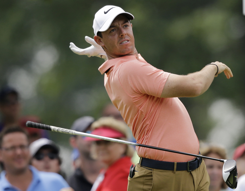 Rory McIlroy, from Northern Ireland, drops his club after teeing off on the ninth hole during the second round of the Bridgestone Invitational golf to...
