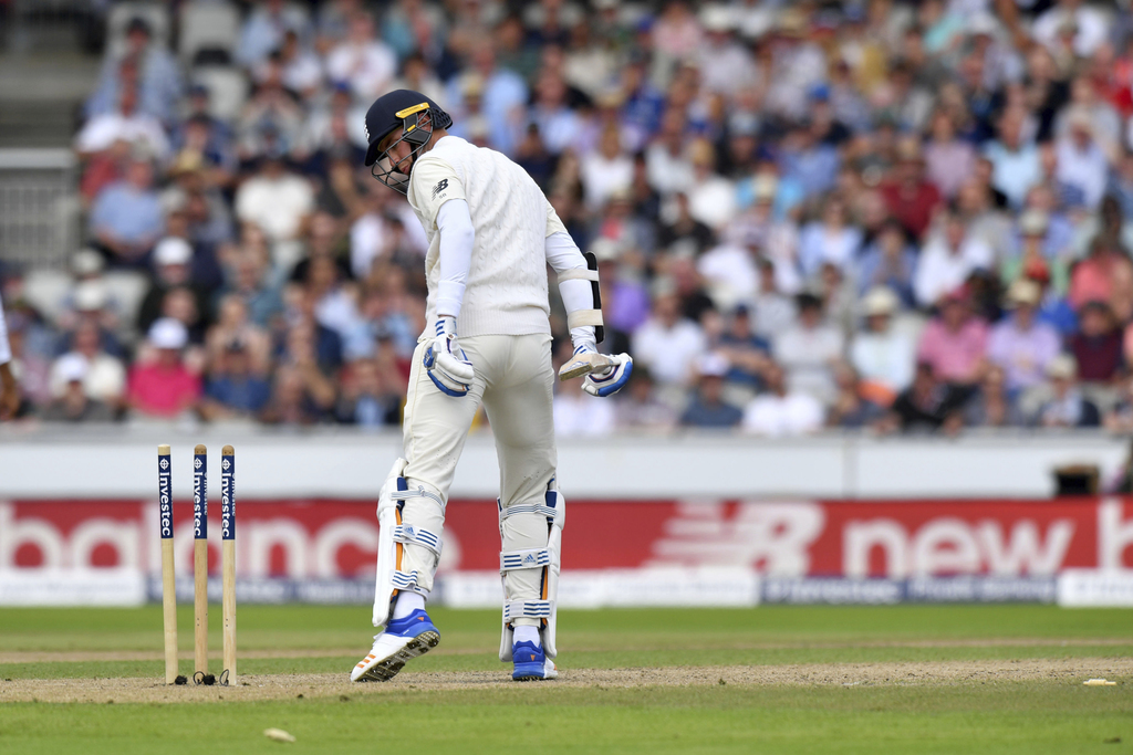 England's Stuart Broad looks at his stumps after being bowled out by South Africa's Morne Morkel during day two of the Fourth Test at Emirates Old Tra...