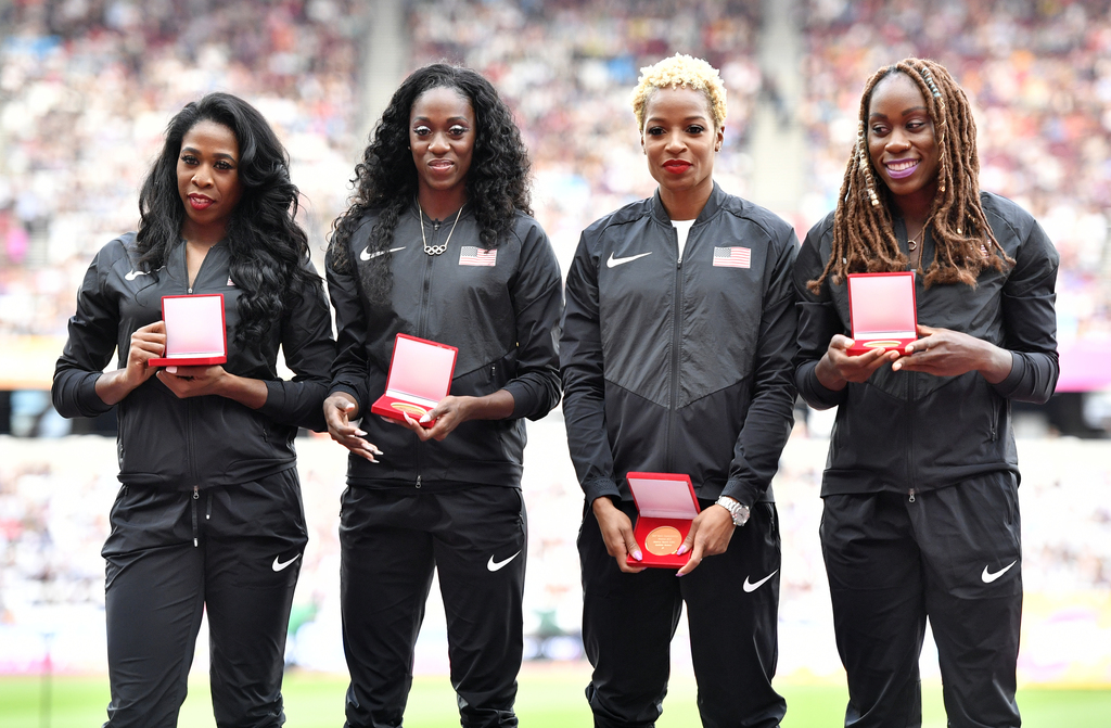 United States' Francena McCorory, Ashley Spencer, Natasha Hastings, and Jessica Beard, from left, pose with their gold medals during the World Athleti...
