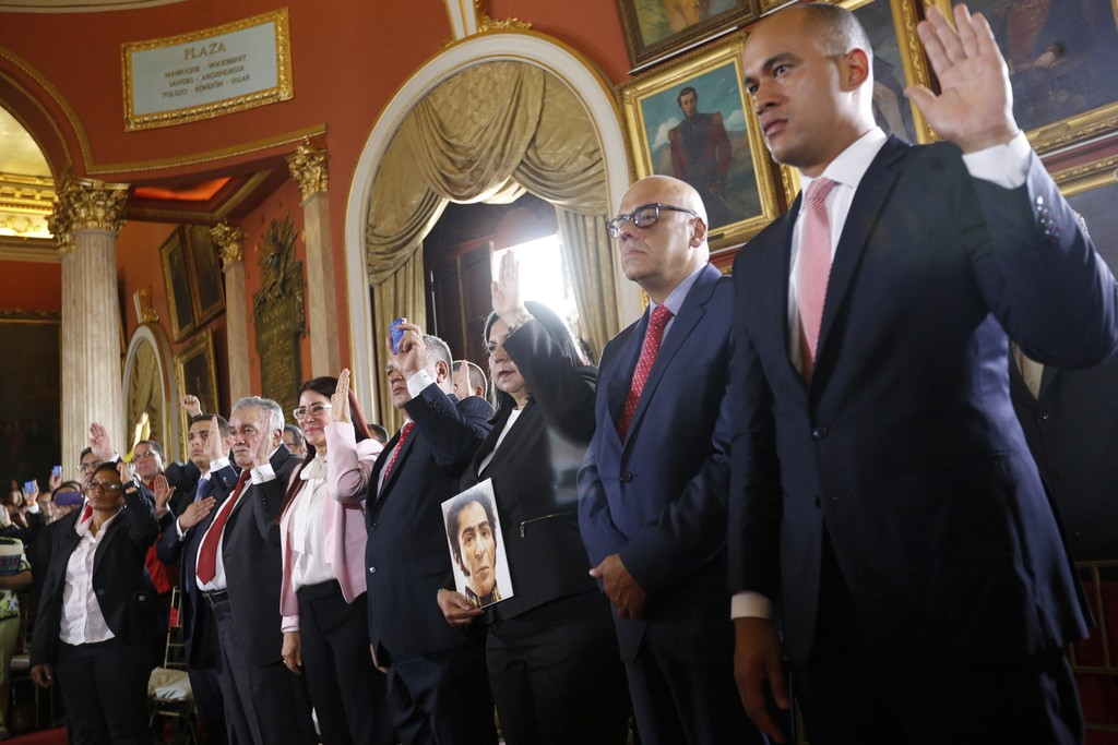 Members of the Constituent Assembly are sworn in, inside the Venezuelan National Assembly, in Caracas, Venezuela, Friday, Aug. 4, 2017. Venezuelan Pre...