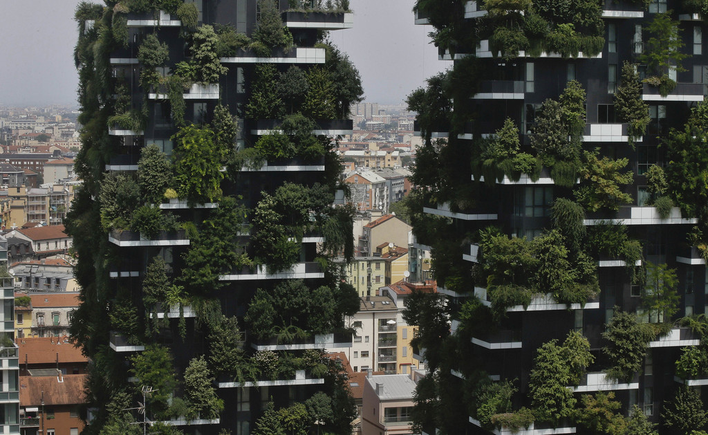 The twin towers of the Bosco Verticale (Vertical Forest) residential buildings at the Porta Nuova district, rise above Milan, Italy, on Thursday, Aug....