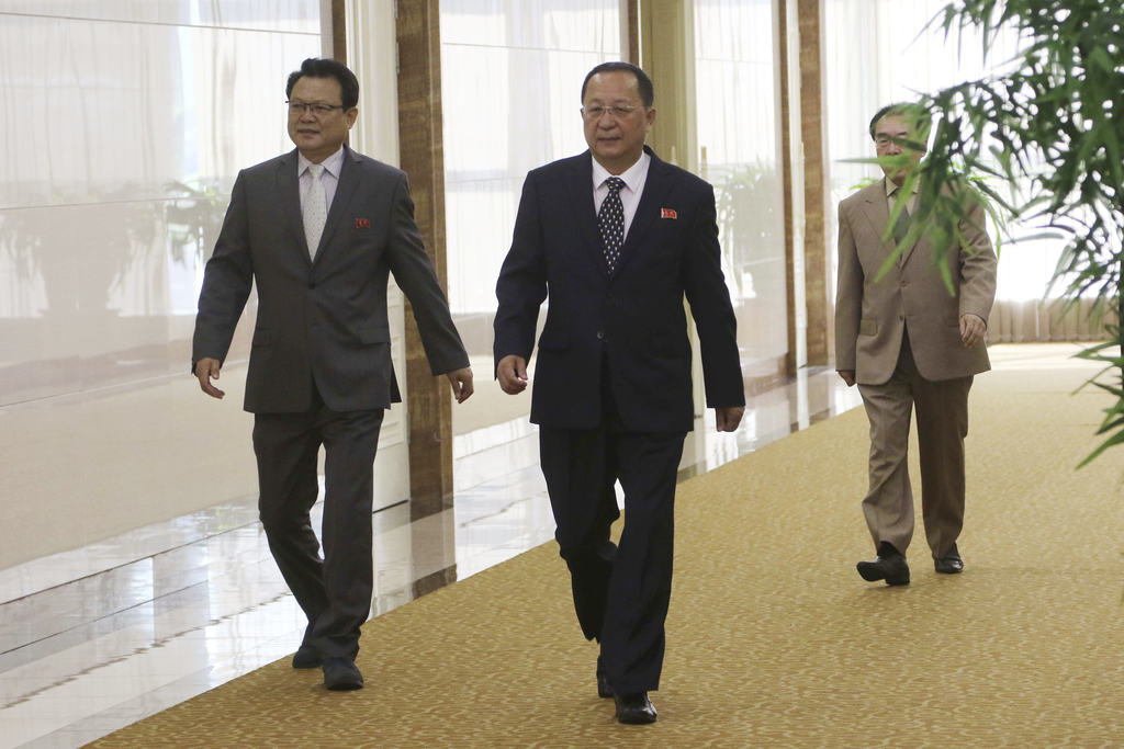 North Korean Foreign Minister Ri Yong Ho, center, walks as he leaves for the Philippines to participate in the ministerial meeting of the Association ...