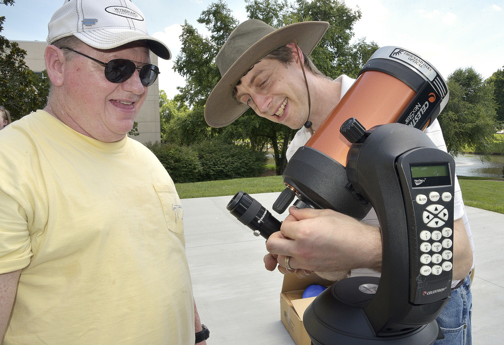 FILE - In this June 29, 2017 file photo, David Chrismon, left, a member of Guilford Technical Community College's student astronomy club, the Stellar ...