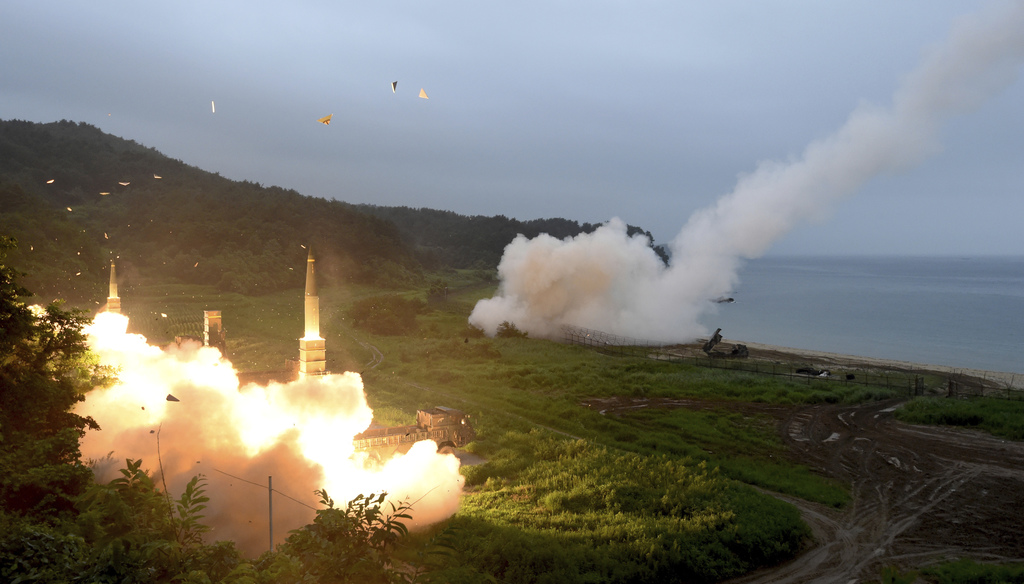 In this photo provided by South Korea Defense Ministry, South Korea's Hyunmoo II Missile system, left, and a U.S. Army Tactical Missile System, right,...