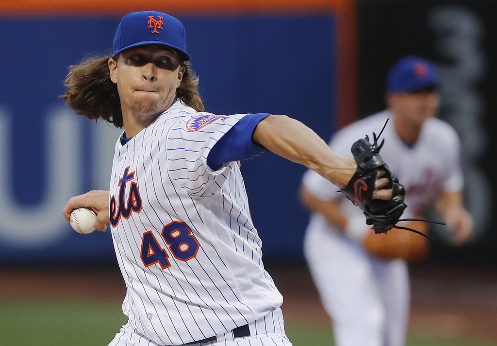New York Mets starting pitcher Jacob deGrom (48) delivers against the Los Angeles Dodgers during the first inning of a baseball game, Friday, Aug. 4, ...