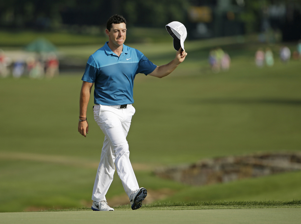 FILE - In this May 17, 2015, file photo, Rory McIlroy, of Northern Ireland, tips his cap to the crowd as he walks up to the 18th green before winning ...