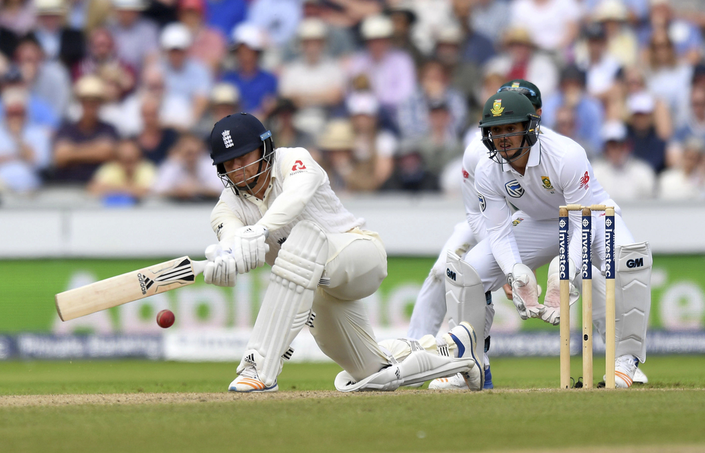 England's Jonny Bairstow is given out lbw as he attempts a sweep shot on 99 runs during day two of the Fourth Test at Emirates Old Trafford in Manches...