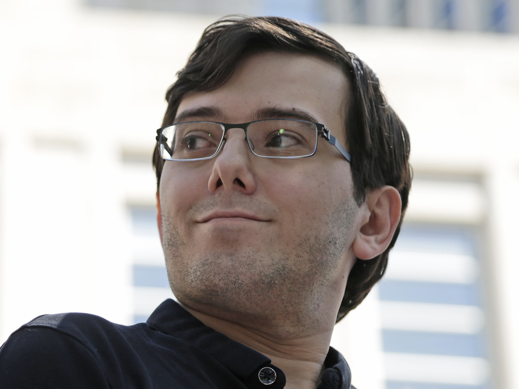 Martin Shkreli talks with reporters after leaving federal court in New York, Friday, Aug. 4, 2017. Shkreli, the eccentric former pharmaceutical CEO no...
