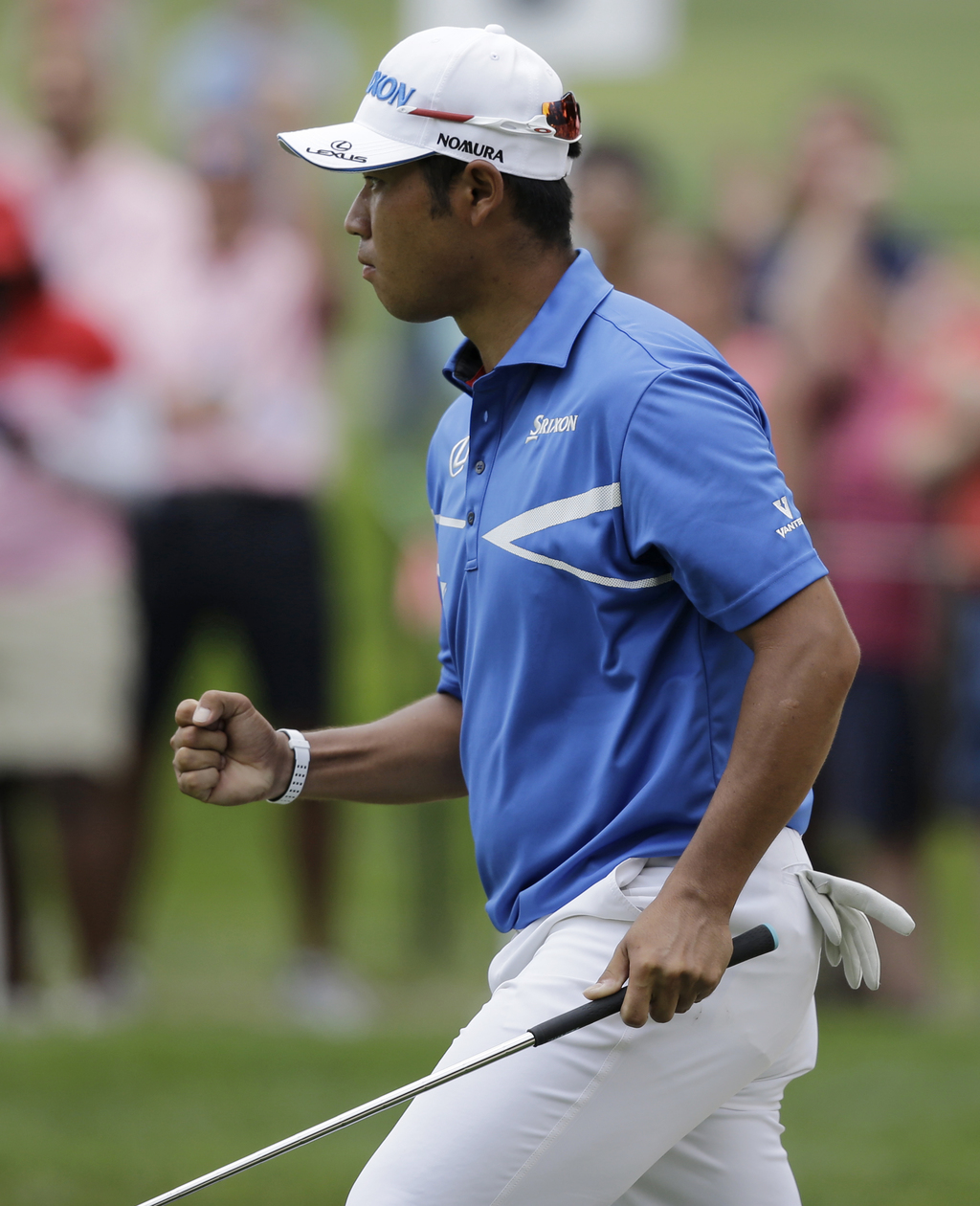 Hideki Matsuyama, from Japan, pumps his fist after making a birdie on the eighth hole during the second round of the Bridgestone Invitational golf tou...
