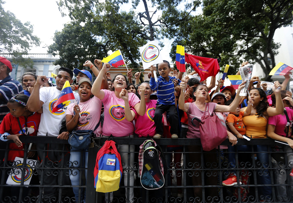 Supporters of Venezuelan President Nicolas Maduro wave national flags outside the National Assembly during the swearing-in ceremony of the Constituent...
