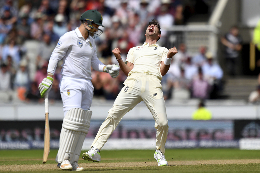 England's James Anderson celebrates after taking the wicket of South Africa's Dean Elgar, left, during day two of the Fourth Test at Emirates Old Traf...
