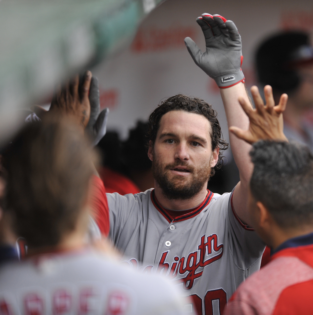 Washington Nationals' Daniel Murphy celebrates with teammates in the dugout after hitting a solo home run during the sixth inning of a baseball game a...