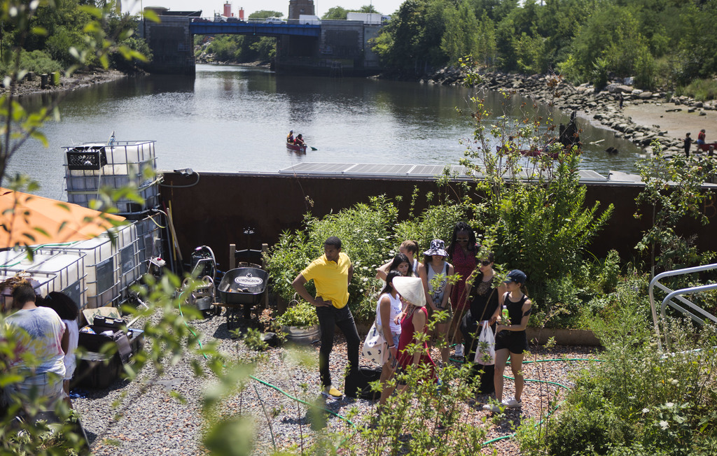 In this Aug. 1, 2017, photo, a group of Kickstarter interns are lead through the Swale Garden in New York. The Swale garden is an old construction bar...