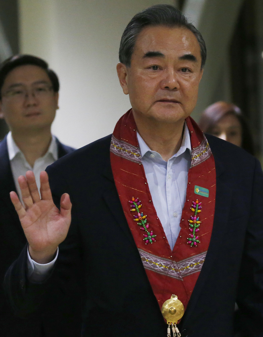 Chinese Foreign Minister Wang Yi waves upon arrival to take part in the 50th ASEAN Foreign Ministers' Meeting and its Dialogue Partners, Saturday, Aug...
