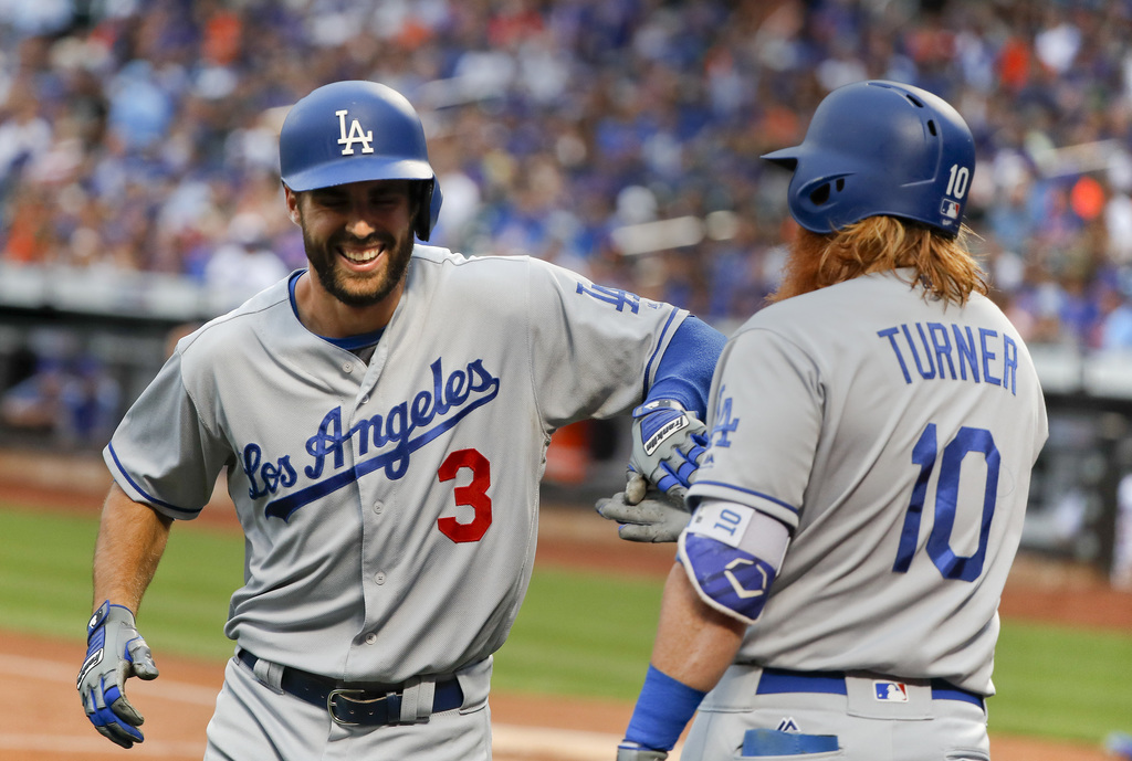 Los Angeles Dodgers' Chris Taylor (3) is congratulated by Justin Turner (10) after hitting a solo home run against the New York Mets during the first ...