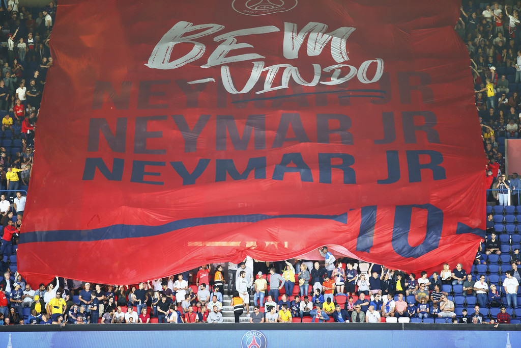 PSG fans welcome Brazilian soccer star Neymar at the Parc des Princes stadium in Paris, Saturday, Aug. 5, 2017, during his official presentation to fa...