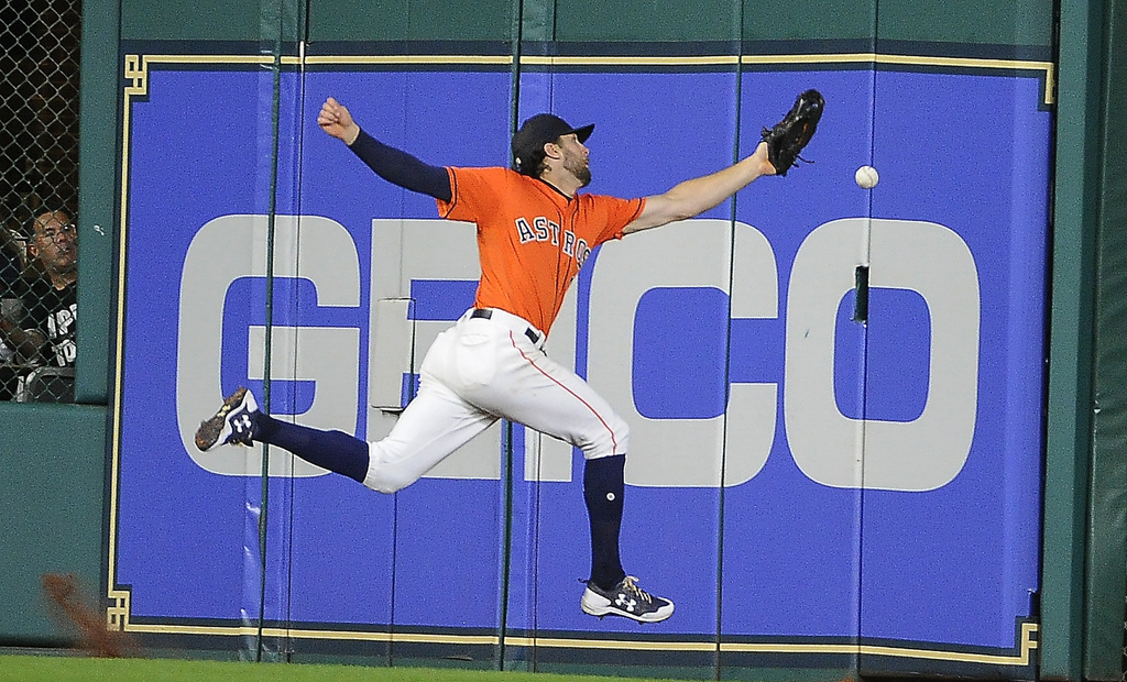 Houston Astros center fielder Jake Marisnick misses a line drive by Toronto Blue Jays' Kendrys Morales during the sixth inning of a baseball game, Fri...