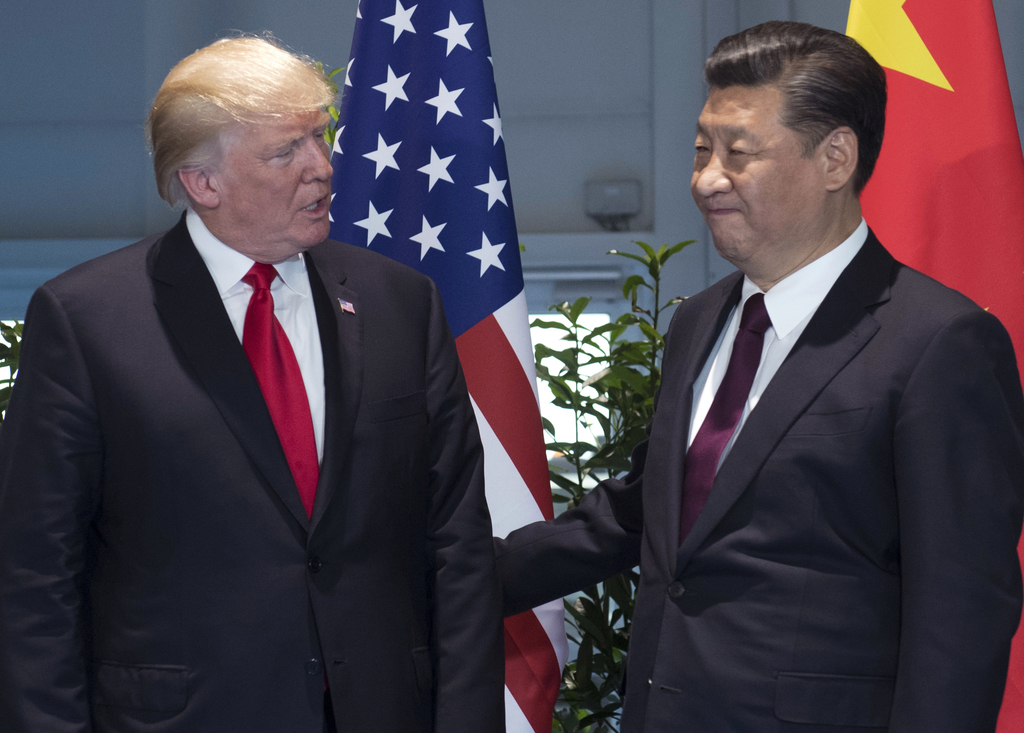 FILE - In this Saturday, July 8, 2017, file photo, U.S. President Donald Trump, left, and China's President Xi Jinping arrive for a meeting on the sid...