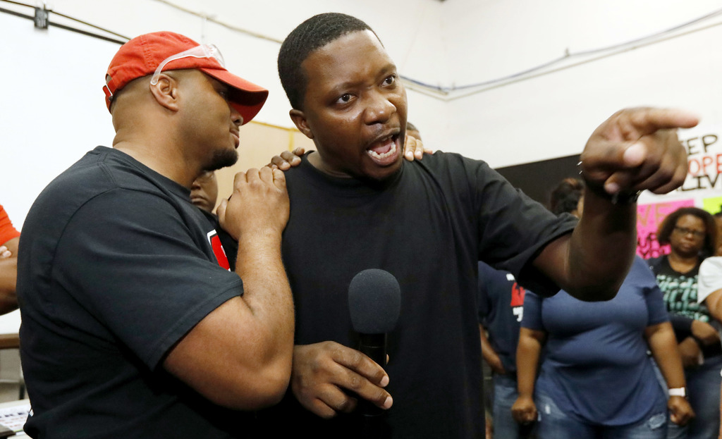 Nissan employee Morris Mock, left, consoles colleague Antonio Hoover as he expresses his disappointment at losing their bid to form a union at the Nis...