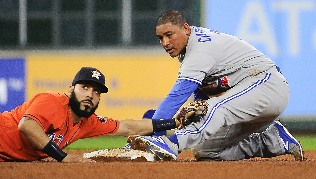Houston Astros shortstop Marwin Gonzalez, left, looks to second base umpire Rob Drake for the call after Toronto Blue Jays' Ezequiel Carrera stole sec...