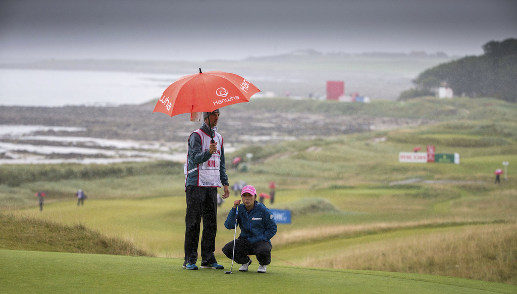 In-Kyung Kim of Korea gets her line before she putts for birdie on the 18th green during day two of the Women's British Open at Kingsbarns Golf Links,...