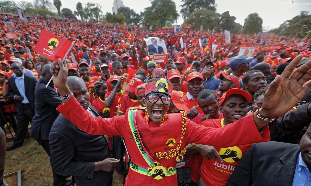 Supporters of Kenya's President Uhuru Kenyatta cheer at an election rally in Uhuru Park in downtown Nairobi, Kenya Friday, Aug. 4, 2017. Kenyans are d...