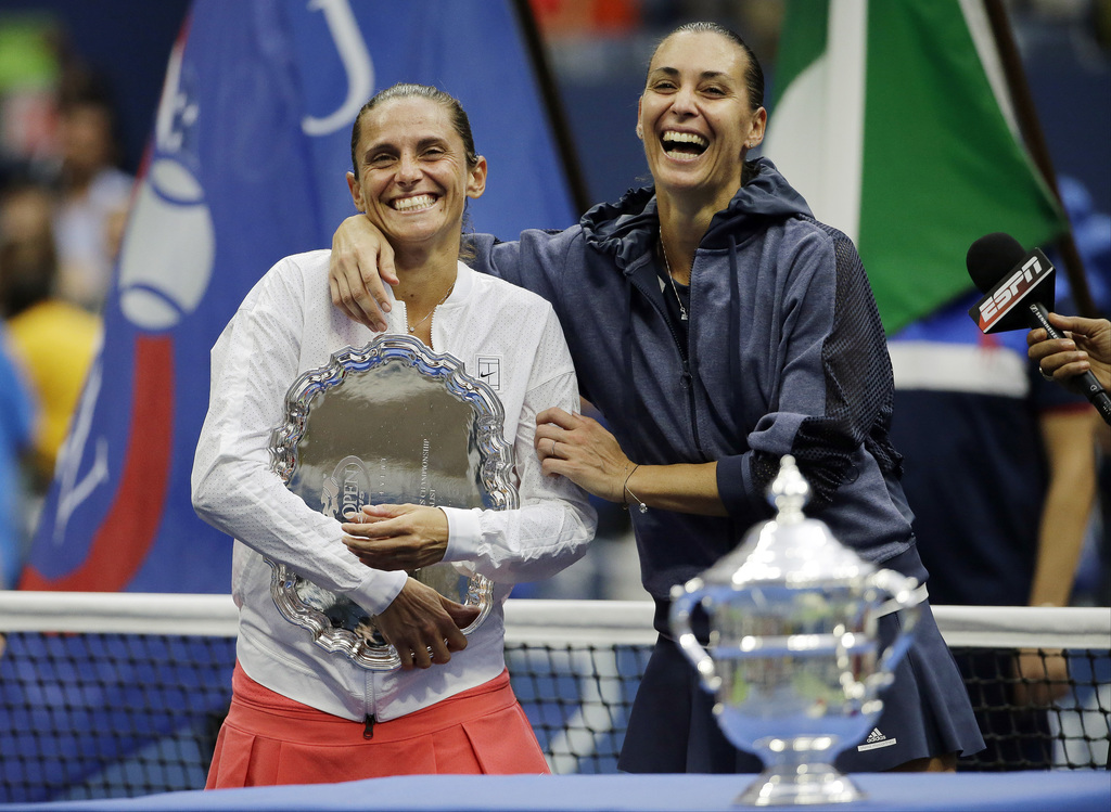 FILE  - In this Saturday, Sept. 12, 2015 file photo Roberta Vinci, of Italy, left, and Flavia Pennetta, of Italy, react during the trophy ceremony for...