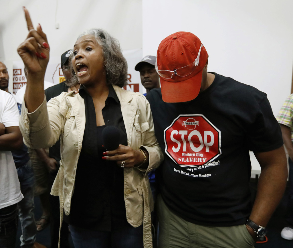 Nissan employee Betty Jones, left, consoles Morris Mock, right, while expressing her disappointment at losing their bid to form a union at the Nissan ...
