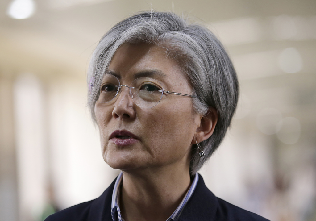 South Korean Foreign Minister Kang Kyung-wha answers questions from reporters as she arrives for the 50th ASEAN Foreign Ministers' Meeting and its dia...