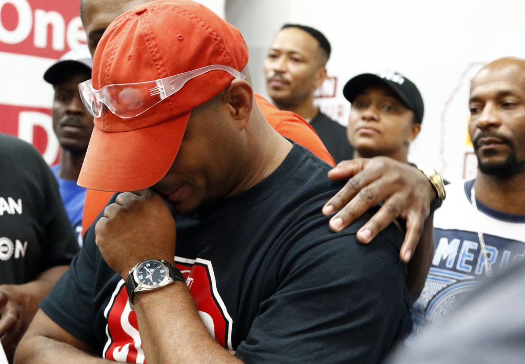 Nissan employee Morris Mock, is consoled as he and other pro-union Nissan employees express their disappointment at losing their bid to form a union a...