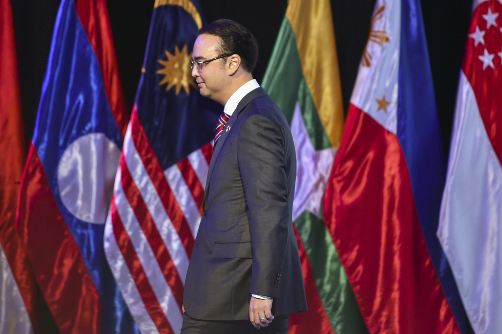 Philippine Foreign Affairs Secretary Alan Peter Cayetano walks to deliver his speech at the opening ceremony of the 50th ASEAN Foreign Ministers Meeti...