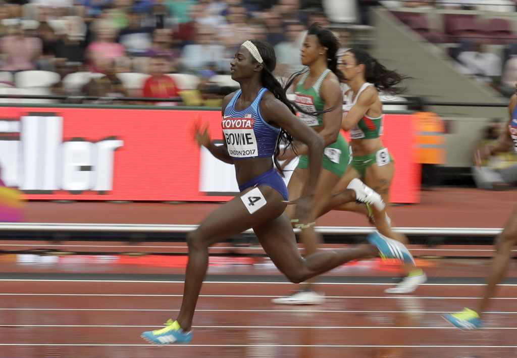 United States' Tori Bowie, left, competes in a women's 100m heat during the World Athletics Championships in London Saturday, Aug. 5, 2017. (AP Photo/...