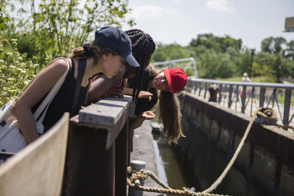 In this Aug. 1, 2017, photo, Katharine Kieferet of Brooklyn and a volunteer with Swale explains how the water is manage in the Swale garden in New Yor...