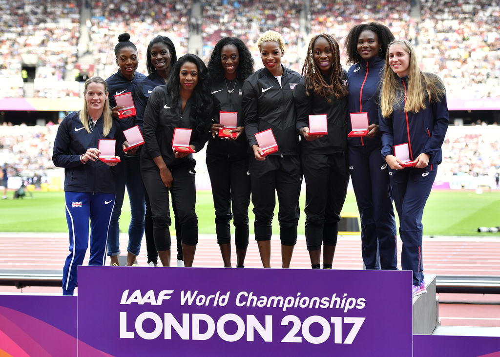 From Left, Britain's silver medal winners Eilidh Doyle, Shana Cox and Christine Ohuruogu, United States' gold medal winners Francena McCorory, Ashley ...