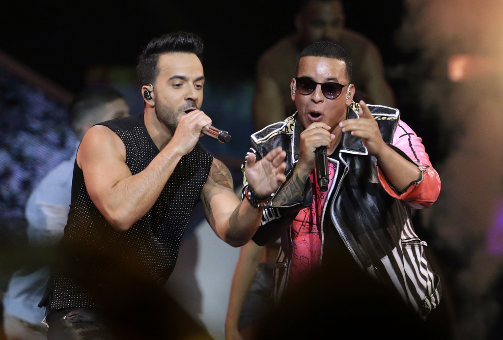 FILE - In this April 27, 2017 file photo, singers Luis Fonsi, left and Daddy Yankee perform during the Latin Billboard Awards in Coral Gables, Fla. On...