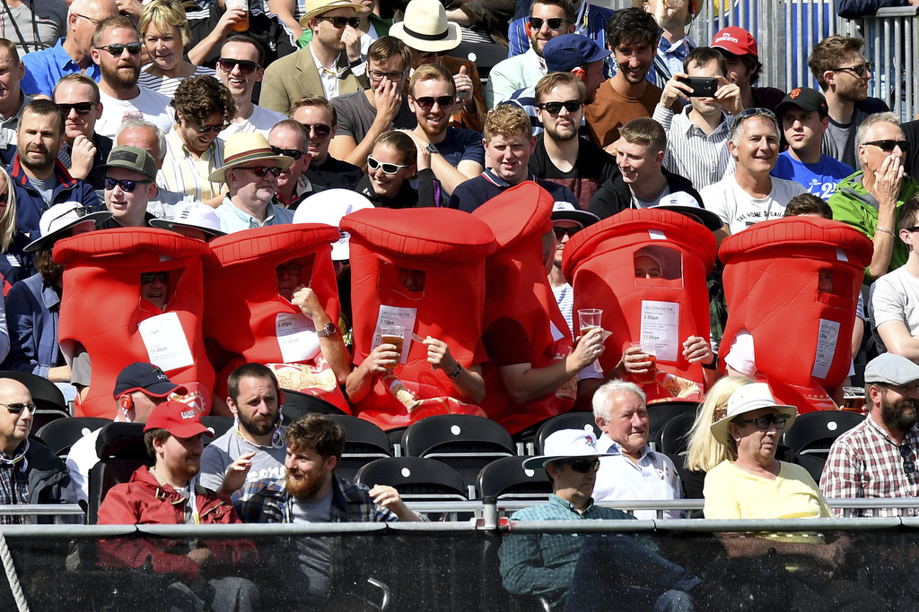 Cricket fans dressed as post boxes for a fun day out watching England play South Africa during day two of the Fourth Test at Emirates Old Trafford in ...