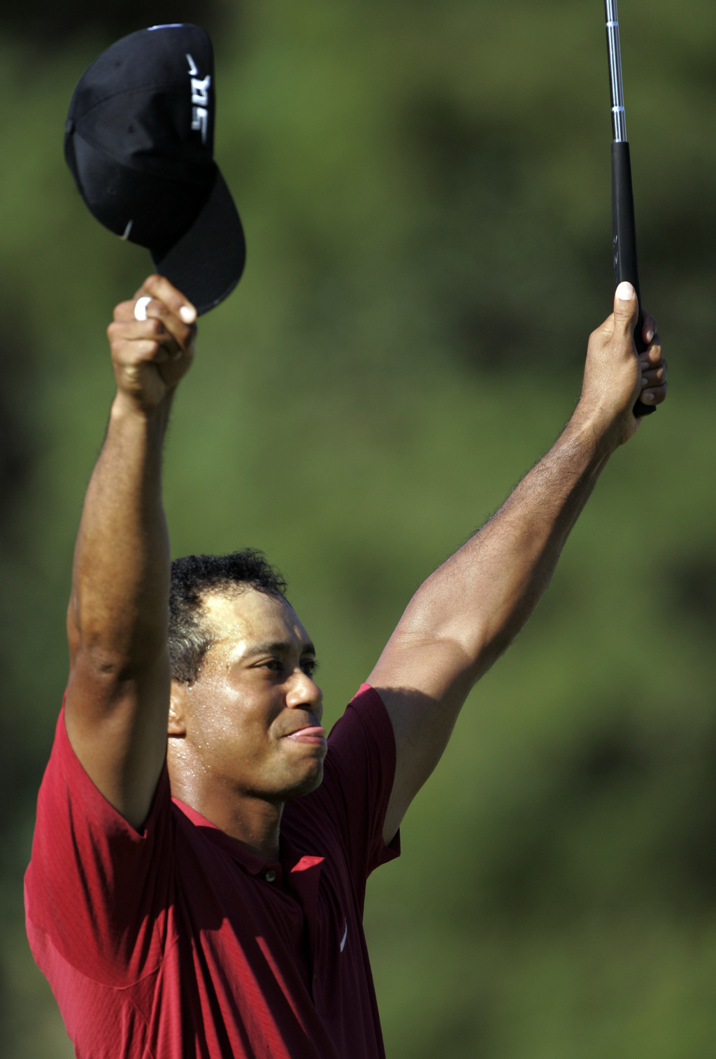 FILE- In this Aug. 12, 2007, file phoot, Tiger Woods celebrates after winning the 89th PGA Golf Championship at the Southern Hills Country Club in Tul...