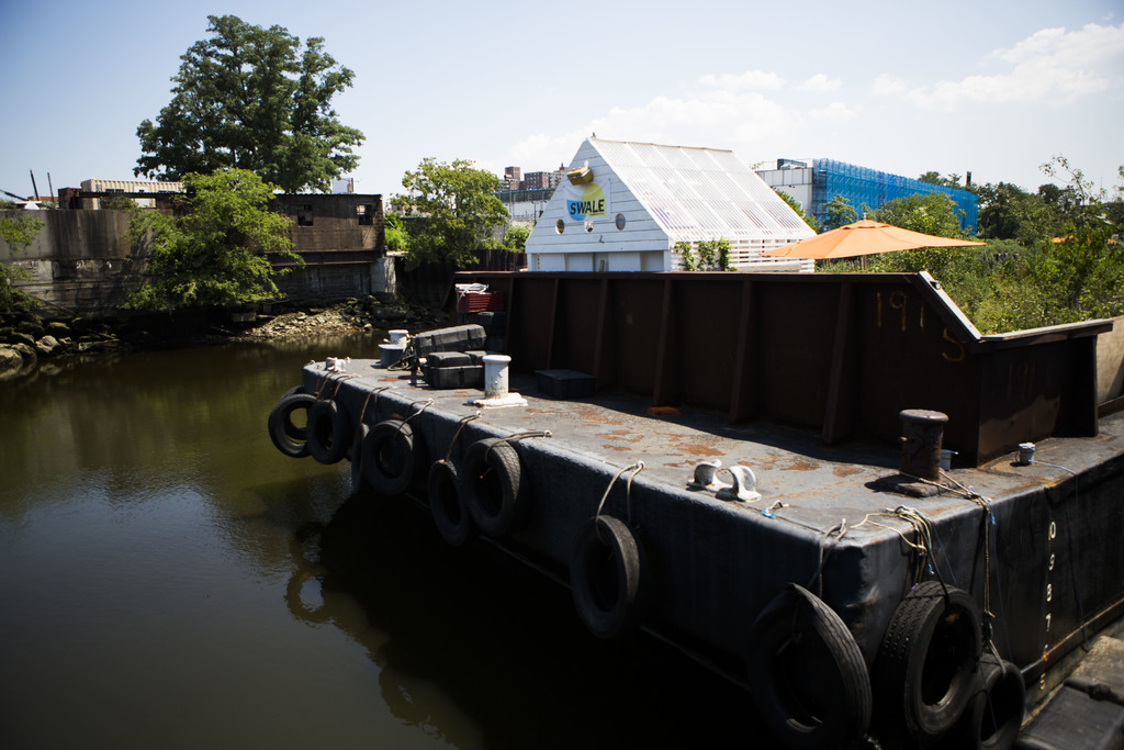 In this Aug. 1, 2017, photo, the Swale garden sits docked in Concrete Plant Park in New York. The Swale garden is an old construction barge planted wi...