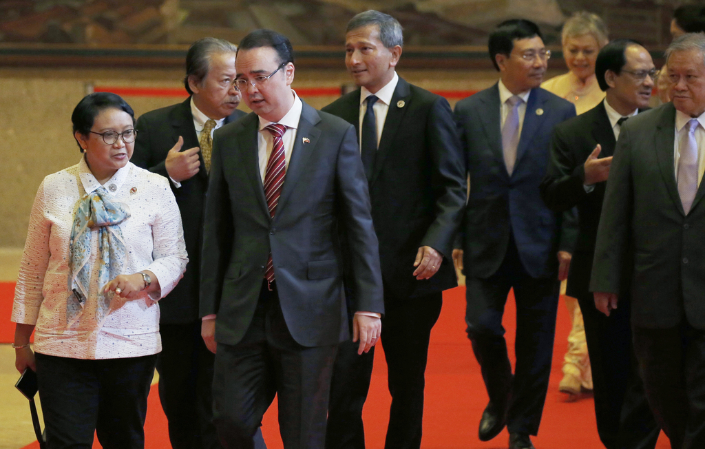 ASEAN foreign ministers walk for the opening ceremony of the 50th ASEAN Foreign Ministers Meeting at the Philippine International Convention Center Sa...