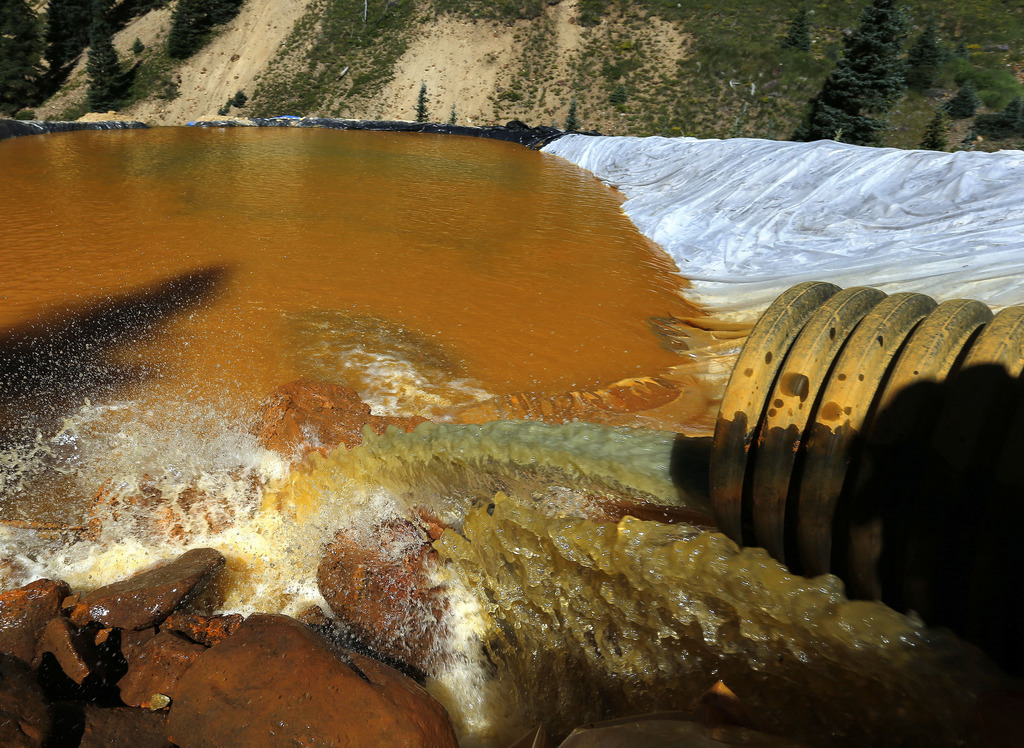 FILE - In this Aug. 14, 2015, file photo, water flows through a series of sediment retention ponds built to reduce heavy metal and chemical contaminan...
