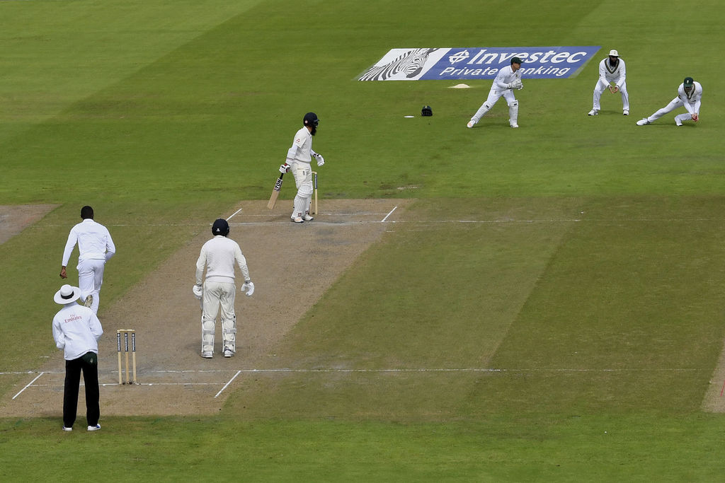 England's Moeen Ali, 4th left, is caught behind by South Africa's Quinton de Kock, right, during day two of the Fourth Test at Emirates Old Trafford i...
