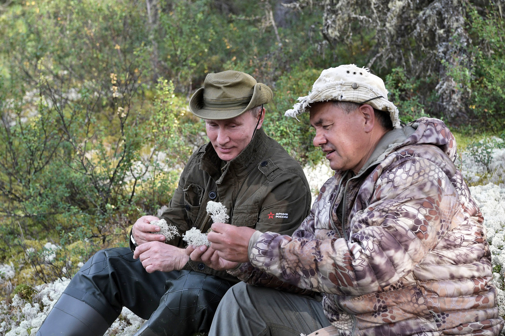 In this photo released by Kremlin press service on Saturday, Aug. 5, 2017, Russian President Vladimir Putin, left, and Defense Minister Sergei Shoigu ...