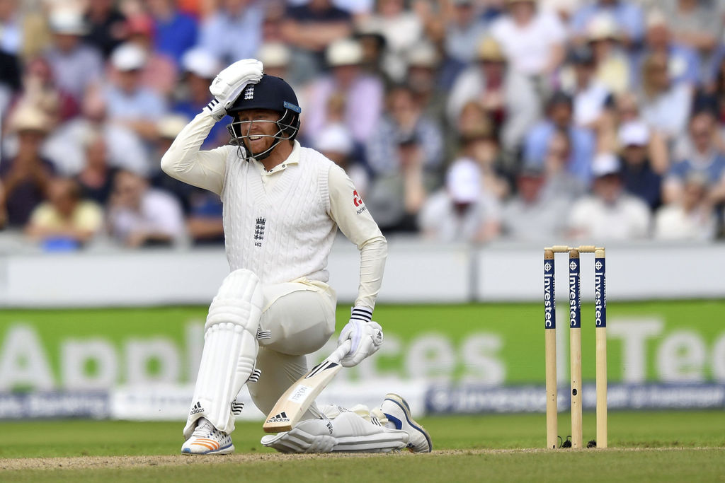England's Jonny Bairstow reacts as he is given out lbw as he attempts a sweep shot on 99 runs during day two of the Fourth Test at Emirates Old Traffo...