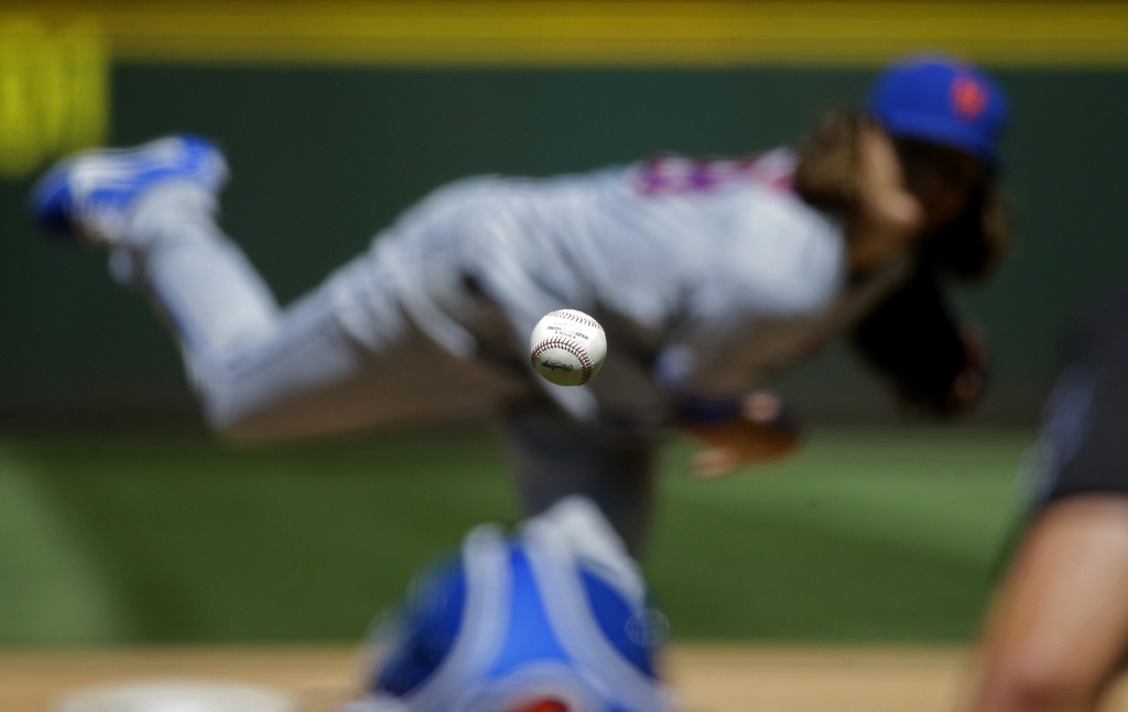 New York Mets starting pitcher Jacob deGrom pitches the ball during the fifth inning of the team's baseball game against the Seattle Mariners in Seatt...