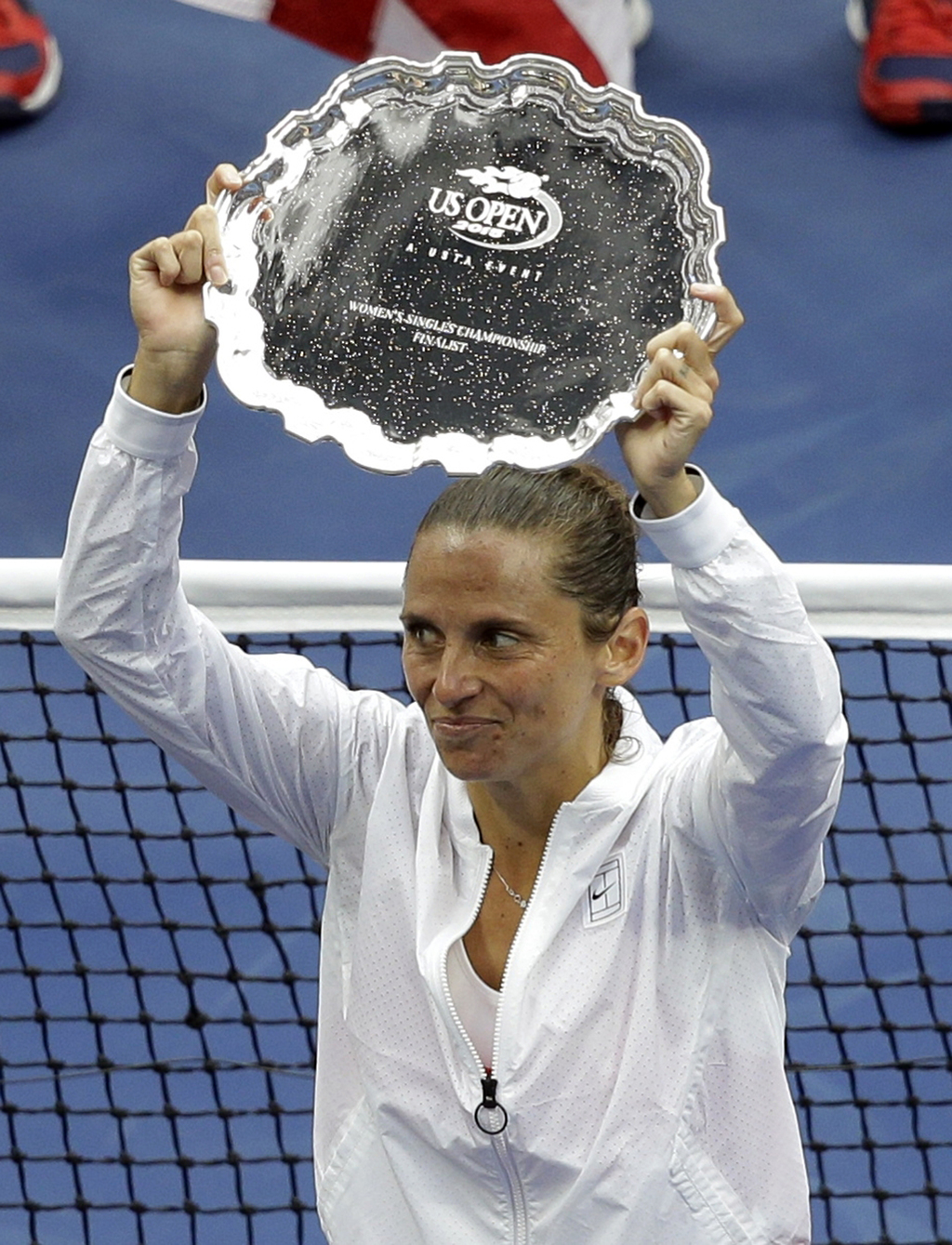 FILE - In this  Saturday, Sept. 12, 2015 file photo Roberta Vinci, of Italy, holds the finalist's trophy after she was beaten by Flavia Pennetta, of I...